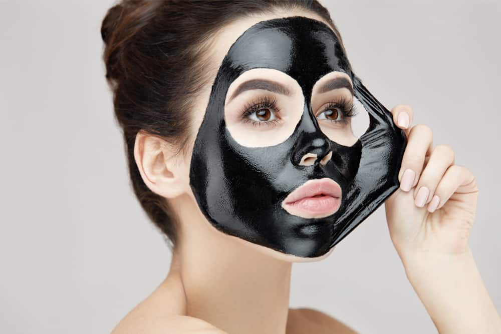 woman with skin refreshing mask on face